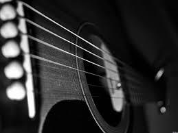 Як розпочати грати на гітарі?